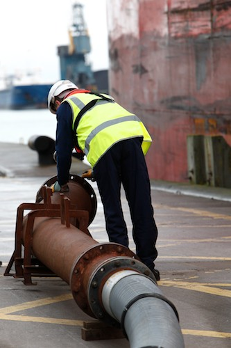 Connecting the Pipeline for another Molasses delivery at the Port of Belfast.